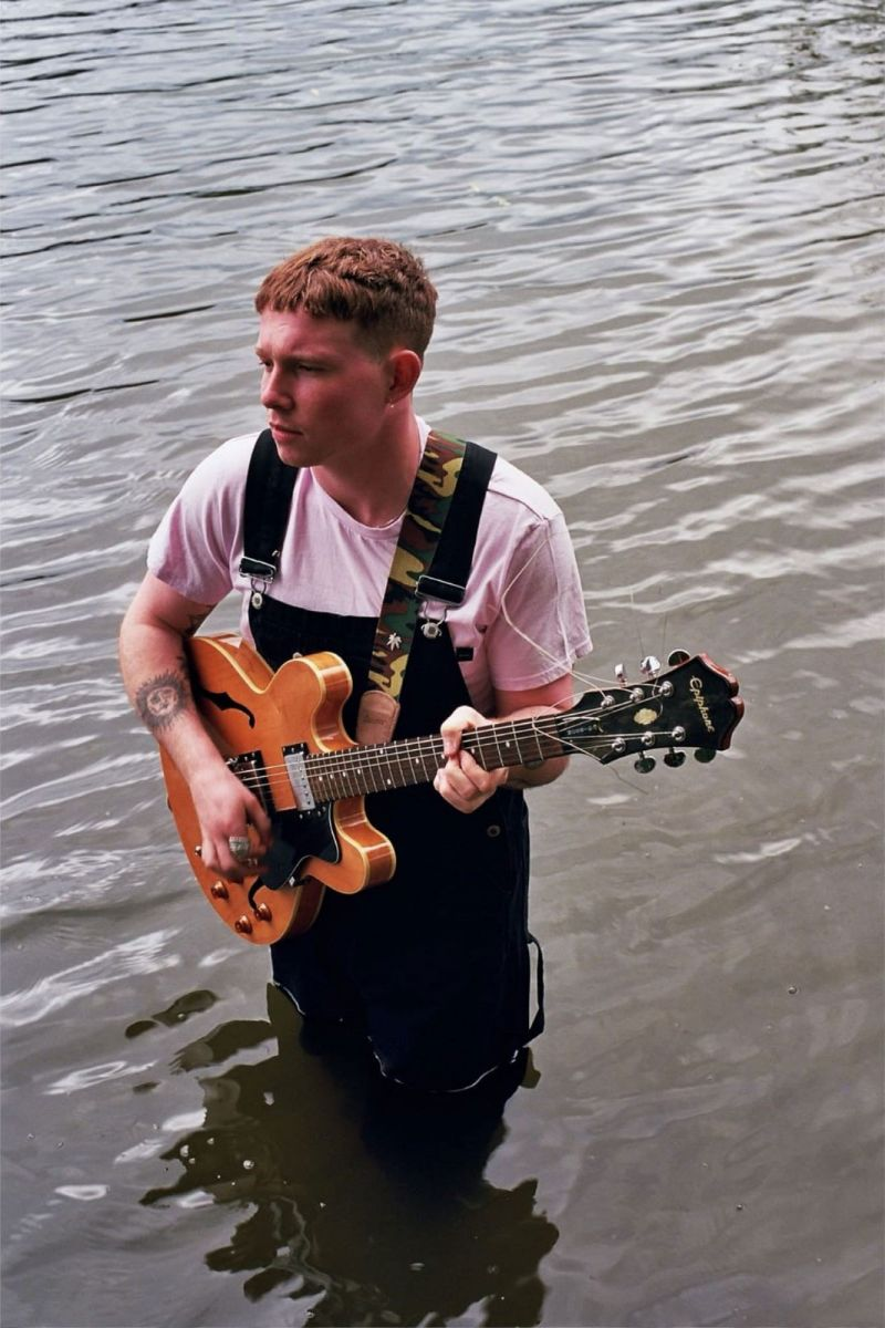 VC Pines plays guitar in water