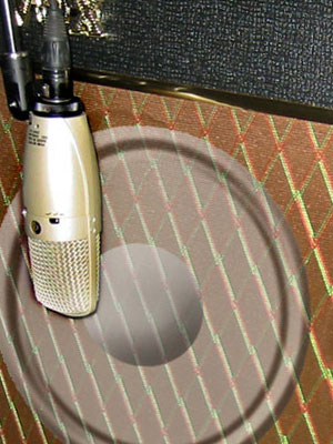 Shure Microphone miking a guitar amp